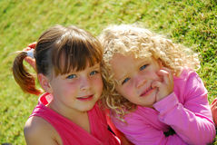 Caucasian girls. Outdoor portrait of two caucasian sisters with blue eyes staring Stock Image