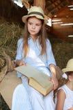 Caucasian girls with books Stock Photo
