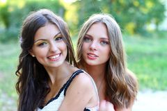 Caucasian girls friends sitting together. Two pretty caucasian girls friends sitting together Royalty Free Stock Image