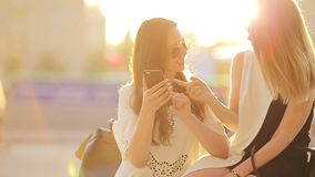 Caucasian girls making selfie background soft sunset light. Young tourist friends enjoy weekend outdoors smiling happy. Happy tourist couple, two girlfriends stock video footage