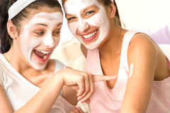Caucasian girls wearing peeling mask having fun royalty free stock images