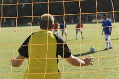 Caucasian Goalkeeper Ready To Save A Shot Stock Photo