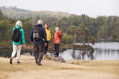 Free Caucasian Grandparents Walk To Their Grandchildren To Admire The Lakeside View, Back View, Lake District, UK Stock Image - 136292841