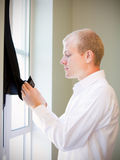 Caucasian groom checking his jacket, getting ready for weddi Stock Image