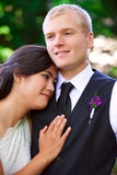 Caucasian groom holding his biracial bride, smiling. Diverse cou Stock Photography
