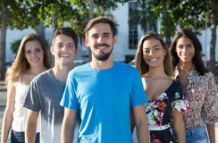 Caucasian guy with beard with hispanic and latin men and woman Stock Photography