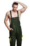Caucasian guy with a naked torso in overalls Stock Photography