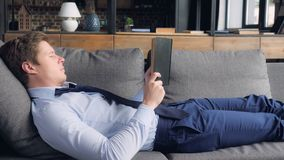 Caucasian guy relaxing at home. stock photography