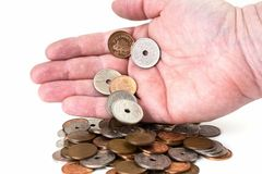 Hand dropping coins Royalty Free Stock Photography