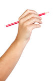 Caucasian hand with red pencil Stock Image