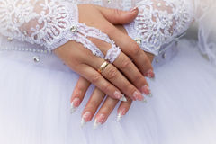 Caucasian  hands with wedding rings Stock Photos