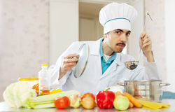 Caucasian handsome chef cooking soup Royalty Free Stock Photos