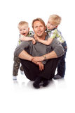 Caucasian happy father with two children sitting on the floor. Royalty Free Stock Photo