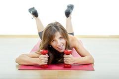 Caucasian happy female fitness model on mat stock images