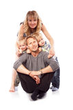 Caucasian happy smiling young family with two children sitting o Stock Photography