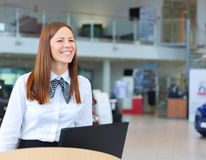 Caucasian happy woman working as a professional receptionist Royalty Free Stock Image
