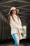 Caucasian High School Senior Candid Smiling in Knit Winter Clothes and Floppy Hat. Candid one female caucasian high school senior outside in knit winter sweater stock photography