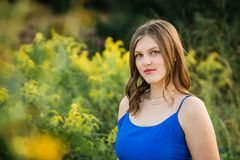 Caucasian High School Senior Girl Outside. One Pretty Caucasian High School Senior Girl Wearing Blue Tank Top Royalty Free Stock Photography