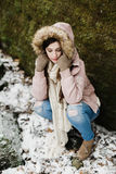 Caucasian High School Senior Outside Looking Down. One female caucasian high school senior outside winter wearing winter coat, scarf and gloves looking down Royalty Free Stock Photo