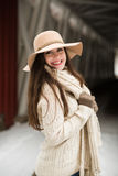 Caucasian High School Senior Smiling in Knit Winter Clothes and Floppy Hat. One female caucasian high school senior outside in knit winter sweater, scarf, and Royalty Free Stock Photos