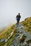 Caucasian hiker with backpack Royalty Free Stock Photos