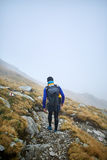 Caucasian hiker with backpack Stock Photo