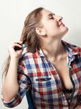 Caucasian hipster girl pulling off hair pin Royalty Free Stock Photography