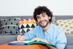 Caucasian hipster at home looking at camera. Caucasian hipster with beard at home looking at camera Stock Photography