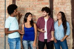 Caucasian hipster man talking with african man and latin america royalty free stock image