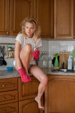 Caucasian housewife on kitchen in morning Stock Photo