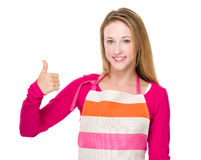 Caucasian housewife showing thumb up Royalty Free Stock Images