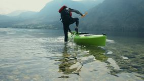 Caucasian kayaker on the lake stock footage