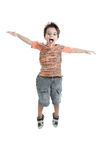 caucasian kid jumping wearing an orange t shirt Royalty Free Stock Images