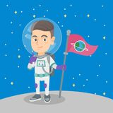 Caucasian kid spaceman with flag on a new planet. Caucasian kid spaceman holding a flag on a new planet and giving thumb up. Happy kid spaceman in space suit Stock Photos
