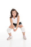 Caucasian Kids. Cute Caucasian girl hitting the ball in volleyball Royalty Free Stock Photography