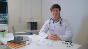 Professional young md in clinic. stock photo