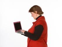 Caucasian kvinna i apelsin och blått Fotografering för Bildbyråer