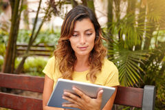Caucasian lady browsing internet on tablet Royalty Free Stock Images