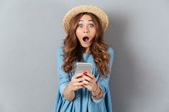 Caucasian lady chatting by phone. Looking camera. Image of shocked young caucasian lady chatting by phone. Looking camera Royalty Free Stock Photos