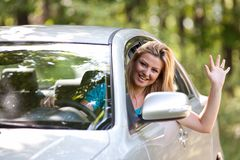 Caucasian lady with new car Stock Photography