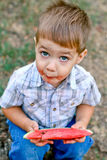 Caucasian little boy eats a slice of watermelon Royalty Free Stock Photos