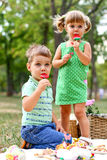 Caucasian little boy and girl eating sweets Stock Photography