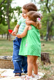 Caucasian little boy and girl eating sweets Royalty Free Stock Photos