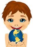 Caucasian little boy holding earth globe Royalty Free Stock Photo