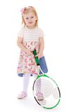 Caucasian little girl with a big tennis racket Stock Photos