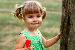 Caucasian little girl eating sweets Stock Photos