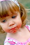 Caucasian little girl eats a slice of watermelon Stock Photo