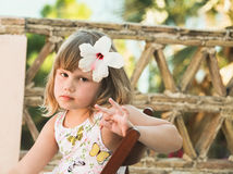 Caucasian little girl with flower in hair Stock Photos