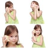 Caucasian little girl holding sea shell Stock Image
