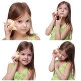 Caucasian little girl holding sea shell Stock Photos